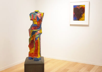 Install shot of colorful Venus de Milo sculpture and small heart painting by Jim Dine