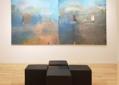 Installation view of Jim Dine diptych painting with tools and implements on a field of blue