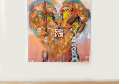 Installation close up of large, abstract heart painting with objects attached by Jim Dine
