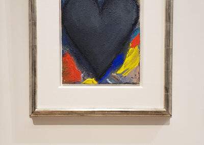 Installation view of Jim Dine painting with black heart and colorful background