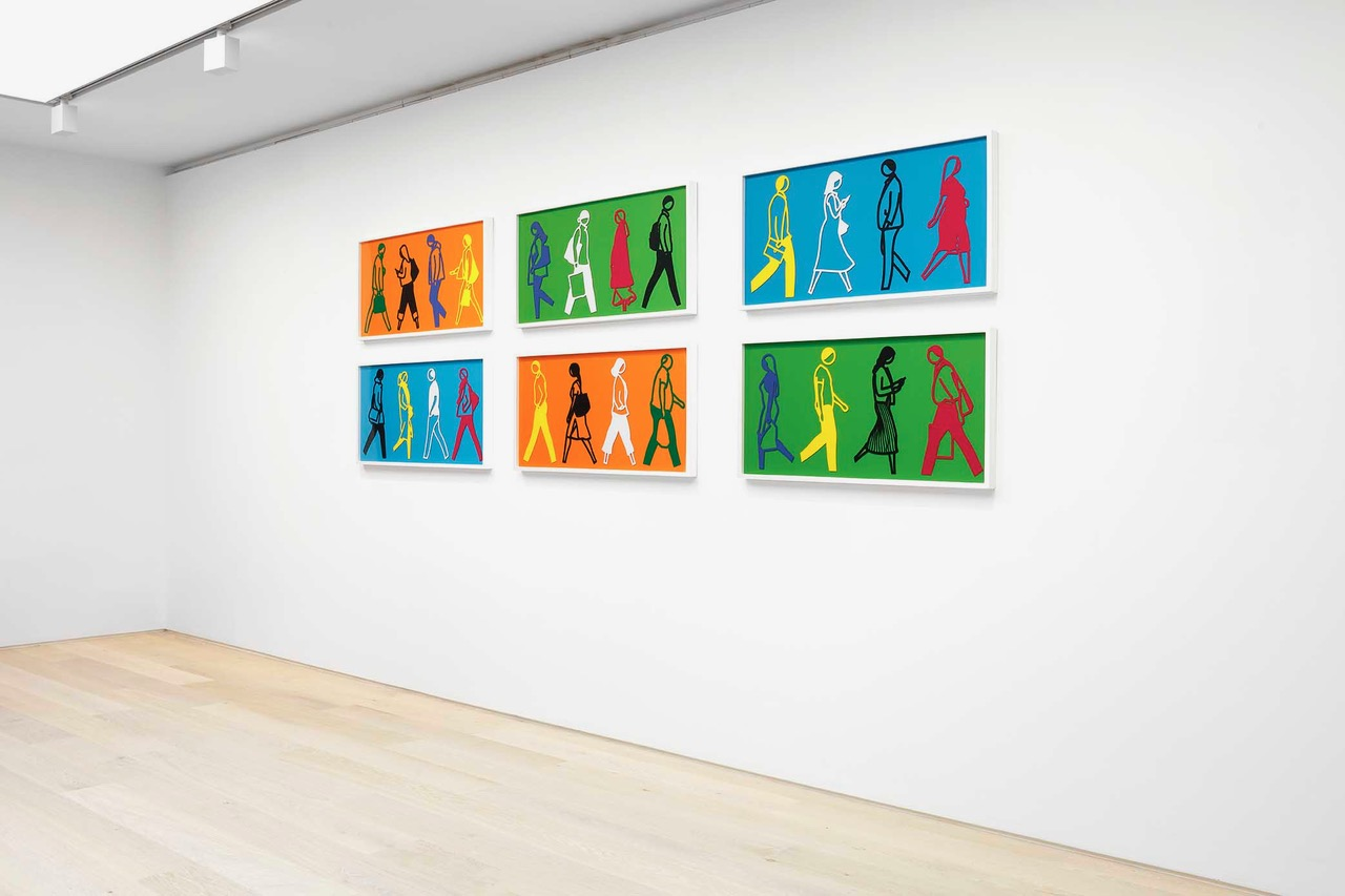 installation photo of colorful suite people walking by Julian Opie