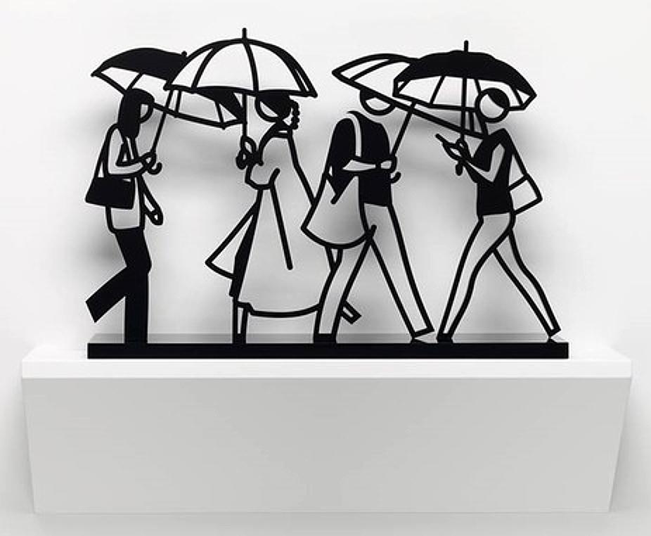 closeup on Julian Opie Summer Rain 1 sculpture depicting four people walking with umbrellas
