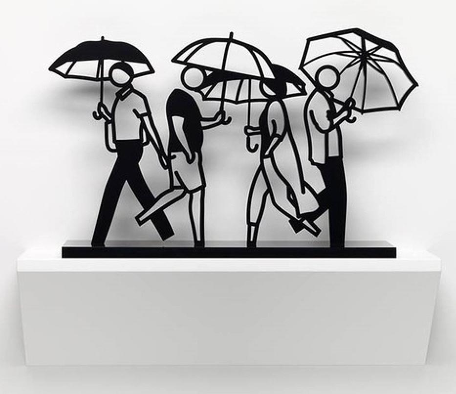 closeup on Julian Opie Summer Rain 2 sculpture depicting four people walking with umbrellas