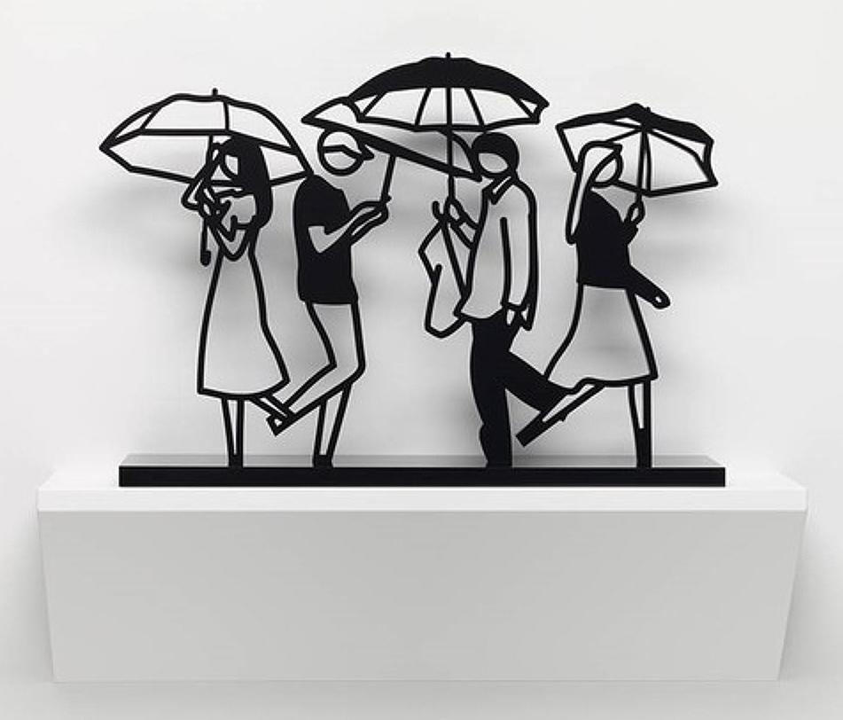 closeup on Julian Opie Summer Rain 3 sculpture depicting four people walking with umbrellas